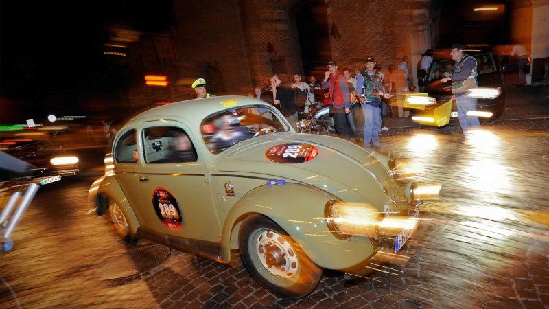 Two vintage original Beetles celebrate the New Beetle's end of production